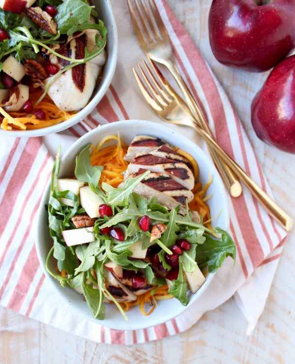 Grilled balsamic chicken & roasted butternut sqaush noodles are topped with a pomegranate apple arugula salad in this healthy, gluten free bowl recipe!