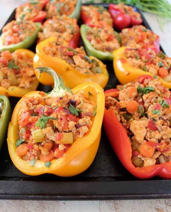 Ground chicken, spices, veggies and buffalo sauce are baked in bell peppers for a healthy recipe that's gluten free, dairy free and Whole30 compliant!