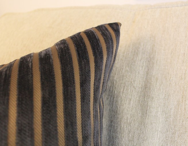 black and brown striped pillow