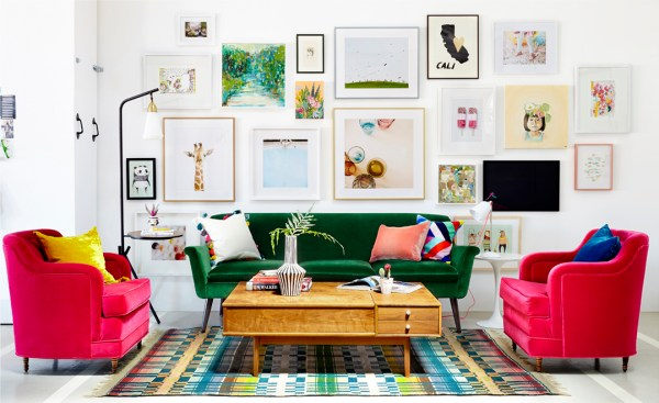 "This room has a white backdrop, but all the color totally takes over without being ""too much"". This Oh Joy's studio, designed by Emily Henderson."