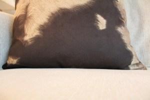 brown cow print pillow