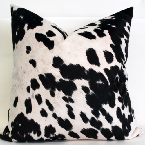 black and white cow print pillow