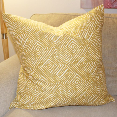 mustard geometric pillow