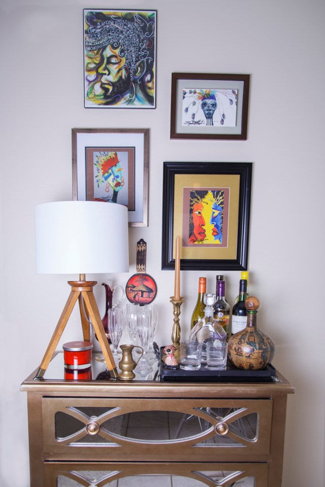 neutral living room | bar cart | dresser used as bar cart | eclectic bar cart | colorful art over bar cart | britt smith photography