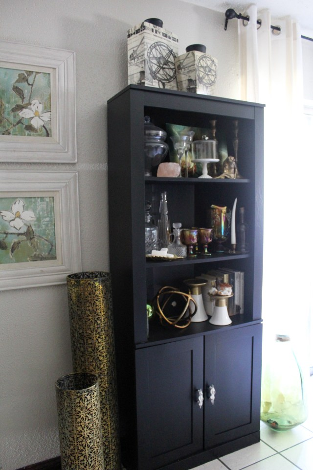painted black bookcase with doors | bookase in living room | bookcase styling