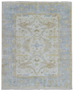 transitional living room with traditional rug | glam living room | neutral transitional living room | blue neutral living room | soft blue living room | oushak oriental rug