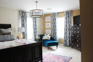 pink and blue transitional bedroom | blue bedroom | pink bedroom | transitional bedroom | glam bedroom | pink diy art | how to transform a master bedroom | white campaign dresser | blue chaise | nate berkus bedding
