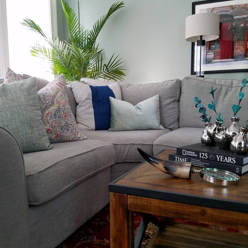 whitney j decor | transitional living room | green living room walls | light green paint color | pottery barn sectional | palm tree in living room