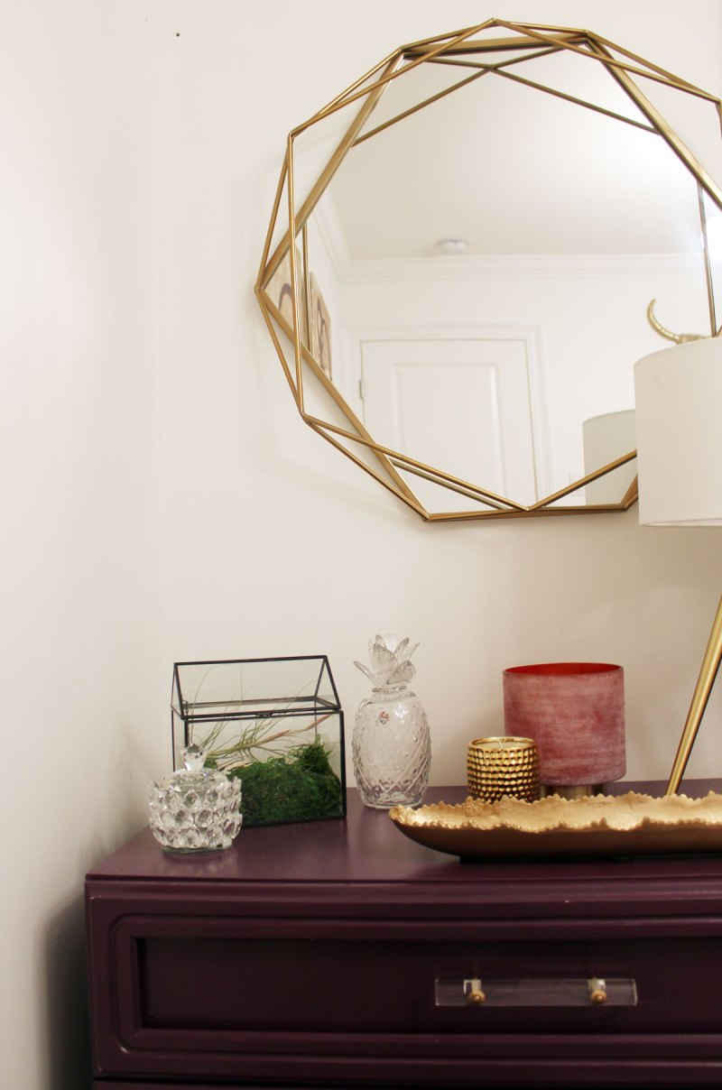 purple dresser and gold geometric mirror