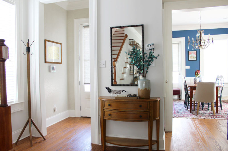 white transitional entryway with wallpaper