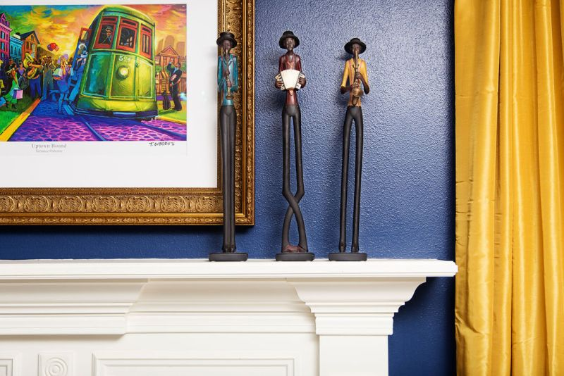 blue walls with african american jazz sculptures