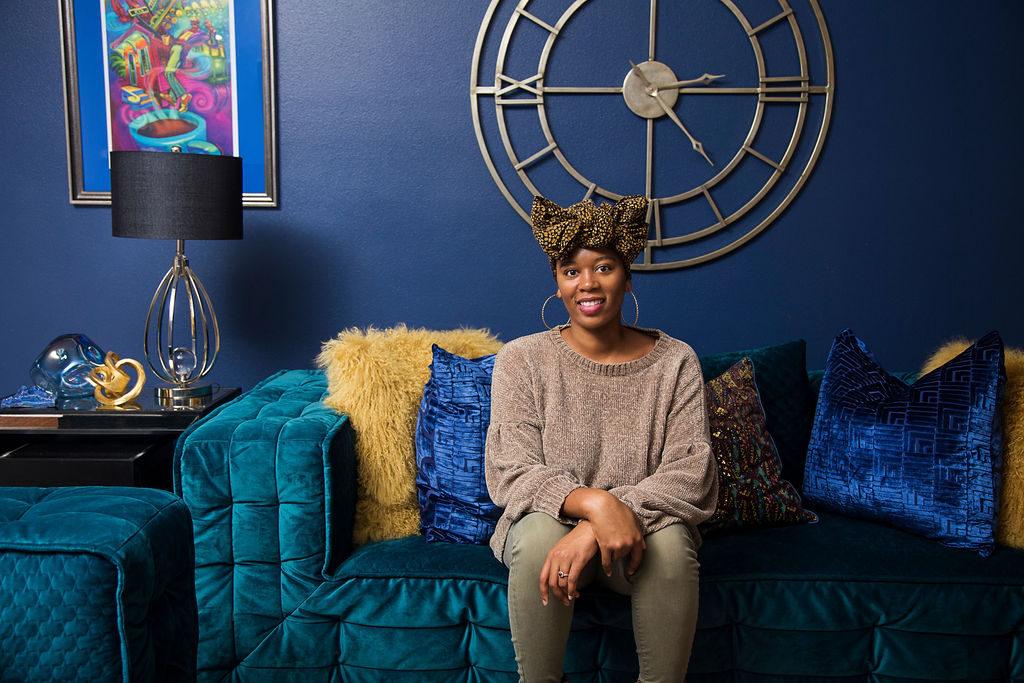 Whitney Jones of Whitney J Decor in bold, blue and green living room