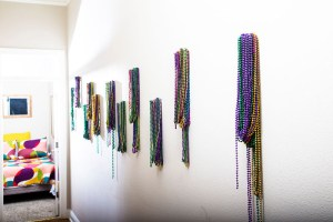 mardi gras beads on wall