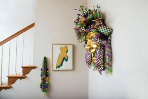 huge mardi gras masks and decor on wall