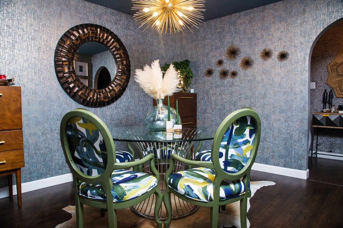 bold blue dining room with green graffiti dining chairs