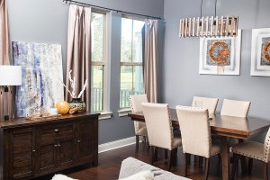 neutral living room with orange accents 1