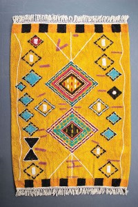 mustard rug with fringe