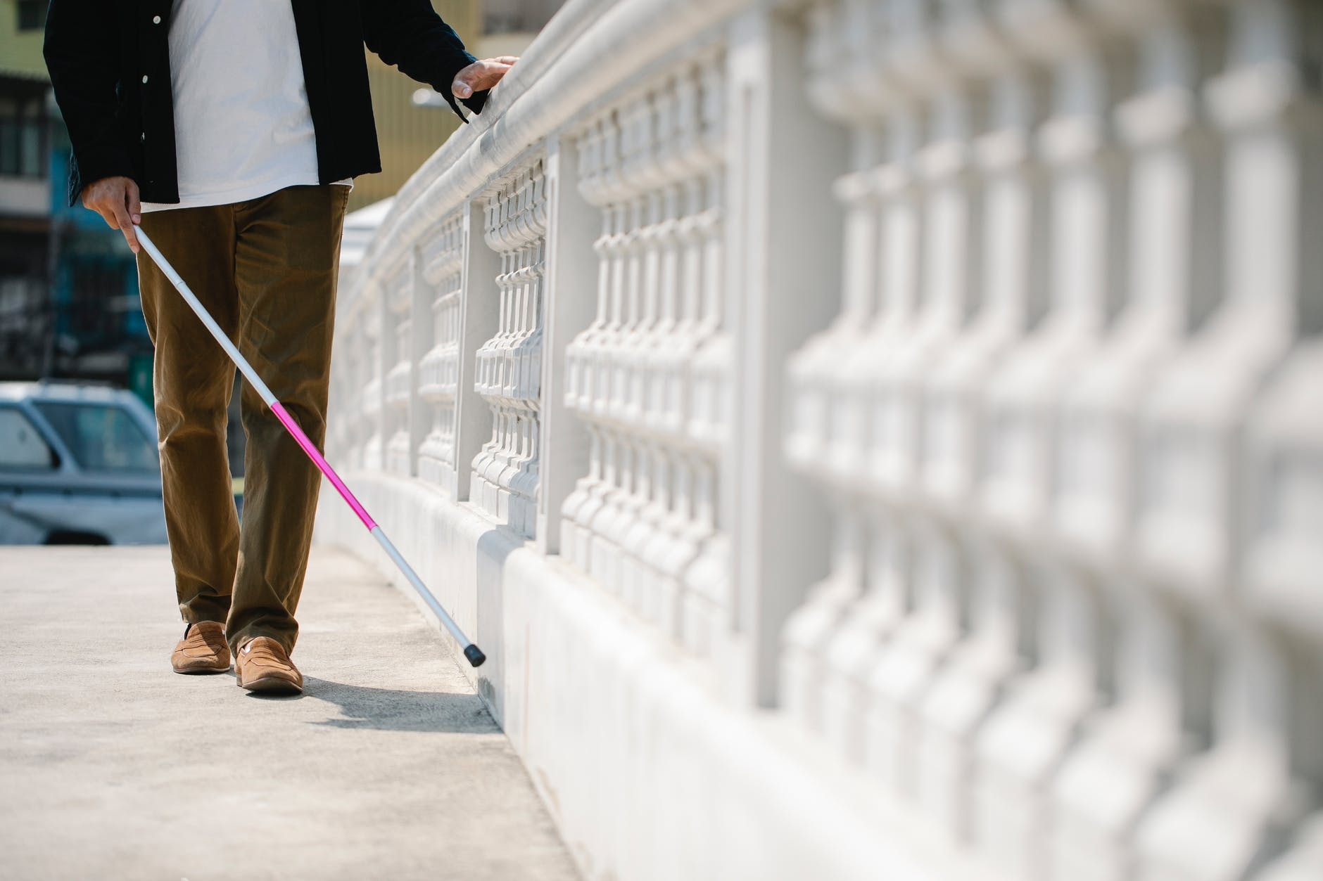 photo of person using cane as a walking guide
