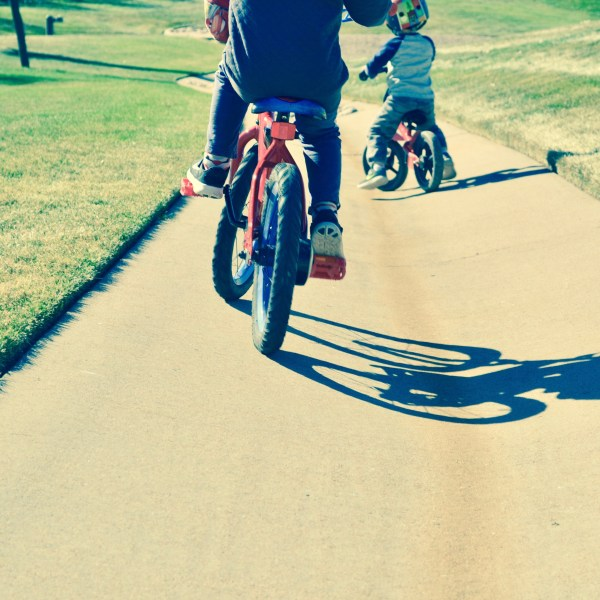 Brothers riding bikes together. It's their favorite thing to do!