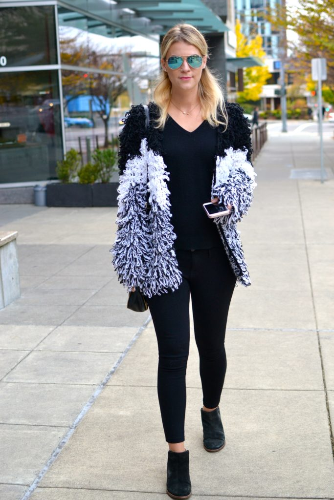 shaggy knit cardigan and black jeans