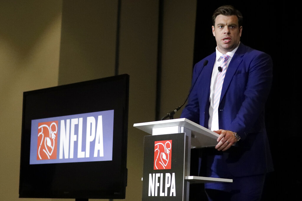 FILE - In a Thursday, Jan. 30, 2020 file photo, Eric Winston, president of the NFL Players Association, speaks at the annual state of the NFLPA press conference, in Miami Beach, Fla. NFL players have approved a new labor agreement with the league that features a 17-game regular season, higher salaries, increased roster sizes and larger pensions for current and former players.