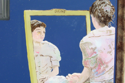 A painting of woman in a pastel dress siting on the floor, looking into a mirror. The painting is done on a mirror and shows the woman from behind and part of her reflection in a mirror she is looking into.