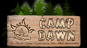 "Logo on wood in front of trees shows someone canoeing at sunrise and text ""Camp Dawn: Adult Camp Experience for ABI Survivors"""