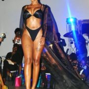 tall caramel Model wearing lingerie and black robe
