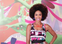 Kalyn James in a print pattern dress with a smile and a Afro which is used for teaser and trailer for web series