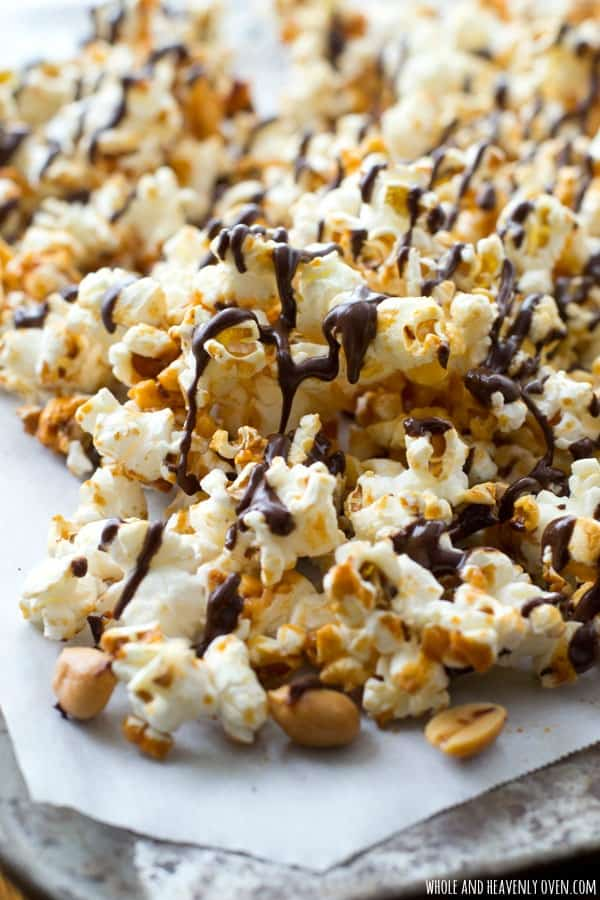 Covered in chocolate and caramel and loaded with crunchy peanuts, this addicting caramel popcorn is definitely the ultimate holiday snack!