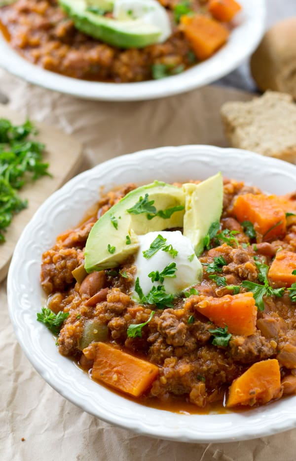 This thick, hearty chili is loaded with tender sweet potatoes, lots of quinoa, and plenty of comfort! Whips up in 30 minutes and ideal for a filling weeknight dinner. @WholeHeavenly