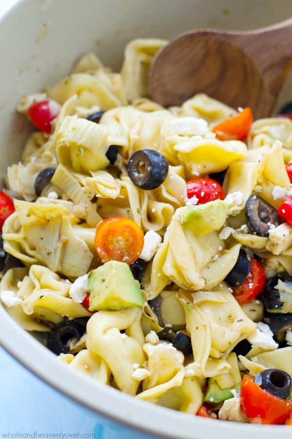 Bring this super-fresh tortellini salad to any picnic and watch it disappear! Loaded with a rainbow of Mediterranean ingredients and tossed in a tangy citrus balsamic dressing.