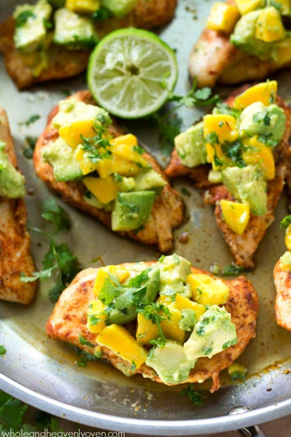 Extra-juicy, cajun-rubbed chicken tenders are piled high with a sweet 'n' spicy mango avocado salsa for one super-easy and flavorful weeknight chicken dinner!