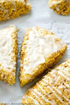 Learn how to make coffee shop-style pumpkin spice scones at home with this easy recipe! They're perfect alongside a cup of coffee.