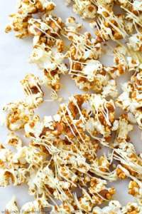 Coated in a gingerbread-spiced caramel sauce and drizzled with plenty of white chocolate, this dynamite caramel popcorn is nearly impossible to stop eating!