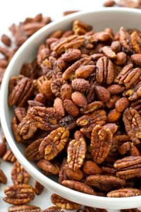 Roasted to perfection in maple syrup and spices, these candied pecans and almonds make the ultimate holiday snack or gift!