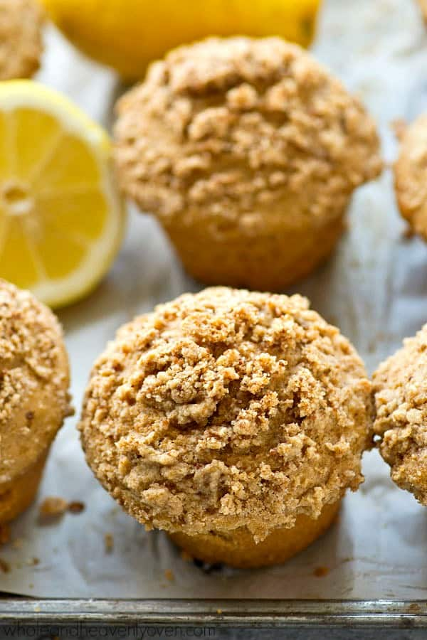 Ultra-fluffy and moist crumb muffins, loaded with lemon flavor and made lighter with greek yogurt.---It's like spring in a muffin!!