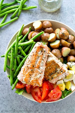 Golden seared salmon, tender fingerling potatoes and fresh green beans, and plenty of other nicoise salad goodness comes together in this beautiful main-dish salad!