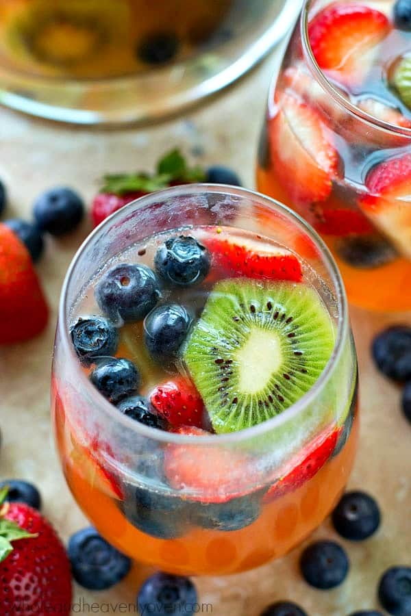 This bubbly and colorful berry sangria is so easy to make you'll find yourself making it all summer long! Perfect for entertaining or for just a casual weekend sipper.