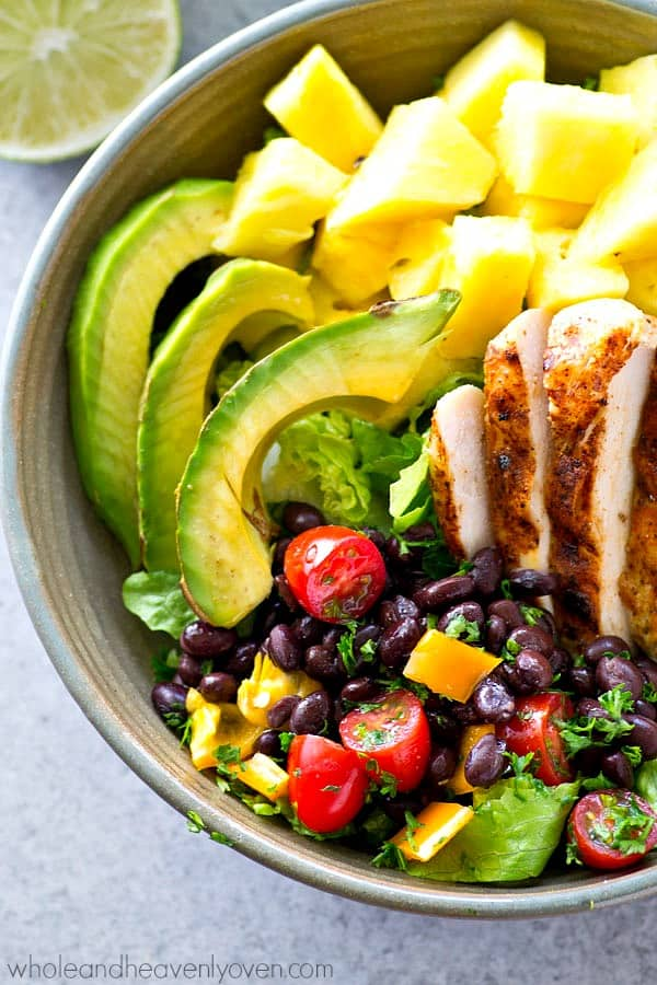 Kickin' grilled chicken, sweet pineapple, and lots of Mexican goodness collide in these super-loaded salad bowls.---A zippy chipotle vinaigrette drizzled on top makes all the flavors sing!