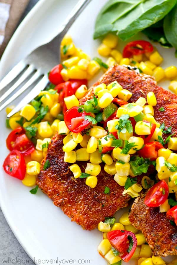 Tender grilled salmon with a smoky rub on the outside is a match made in heaven for a sweet corn pico de gallo piled on top. --- This easy 30-minute dinner packs in a HUGE kick of flavors you'll love!