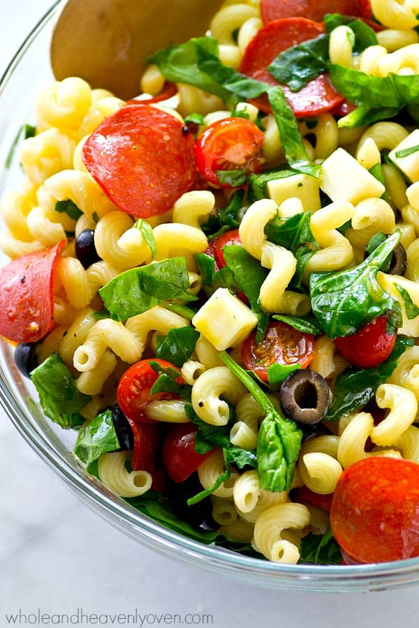Everything you love about pizza...in the form of a healthy Italian pasta salad! This super-easy salad is so simple to throw together, it will be a cookout requirement all summer!