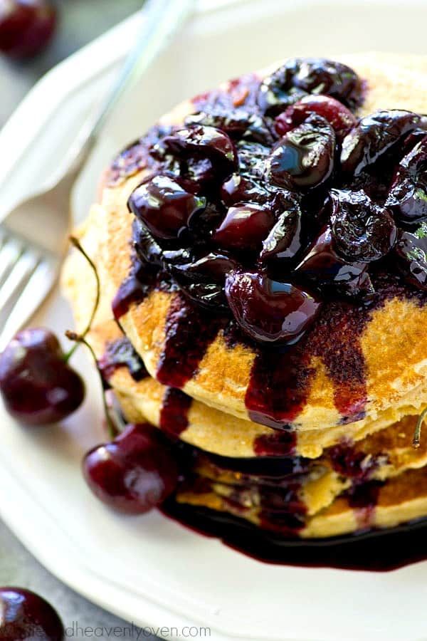 Southern-style citrus cornmeal pancakes are a match made in summer heaven with a sweet fresh cherry compote piled on top! These fluffy pancakes are the ultimate summer weekend breakfast.