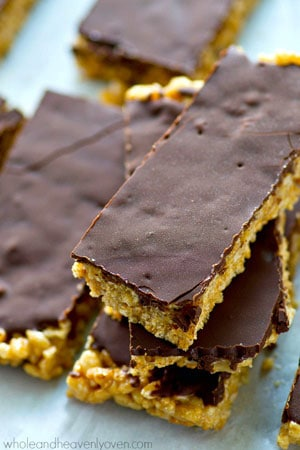 Classic no-bake rice krispie treats are kicked up in a healthy way using cashew butter and a silky chocolate coconut oil topping. Only SIX ingredients in these easy no-bake treats!