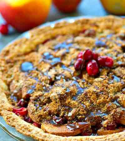 Tart cranberries and sweet apples star in this crumb-covered apple pie that's drizzled with a luscious homemade caramel sauce for one KILLER Thanksgiving pie!