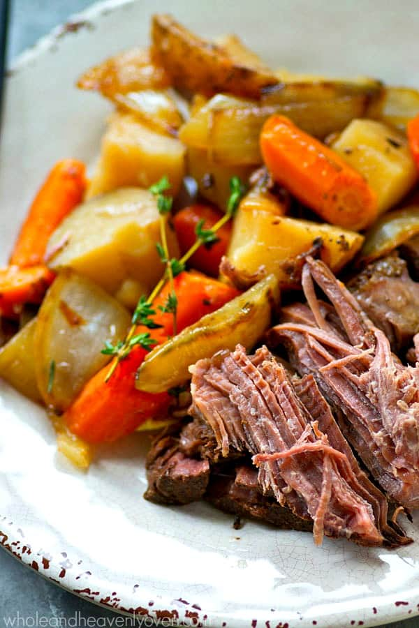 Balsamic vinegar, caramelized onions, and plenty of other veggies make this tender pot roast unbelievably flavorful and the ultimate easiest weeknight winter dinner!