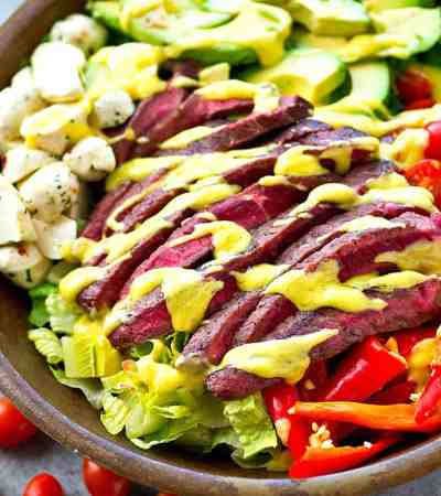 This California-style steak salad is packed full of so many fun salad things it's practically an entire meal by itself! A tangy mango vinaigrette drizzled on top makes all the flavors pop!