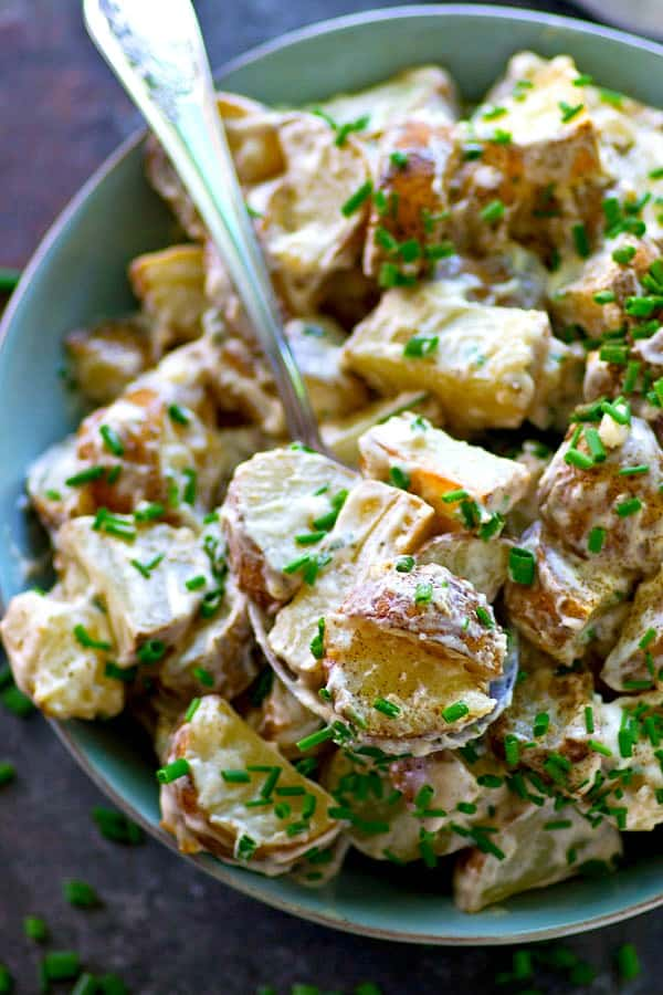 Flavorful roasted potatoes are tossed with a creamy chive ranch dressing for a simple, yet SO nostalgic and summery potato salad you'll want to bring to all those cookouts!