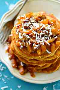 The FLUFFIEST coconut pancakes ever are dressed up with tropical orange pineapple compote for one gorgeous tropical-style stack of pancakes!