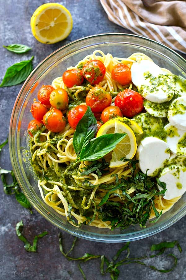 Juicy charred tomatoes, soft mozzarella cheese, and tons of flavorful lemon basil dressing make this spaghetti salad the ultimate summer side that you'll find yourself making again and again.